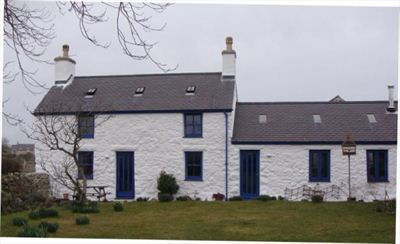 The externally lime washed farmhouse